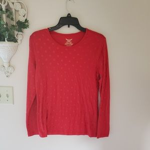 Red polka dotted long sleeve top